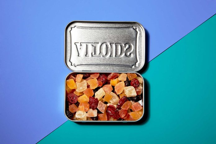 Illustration of portion control trick: dried fruit in a mint tin