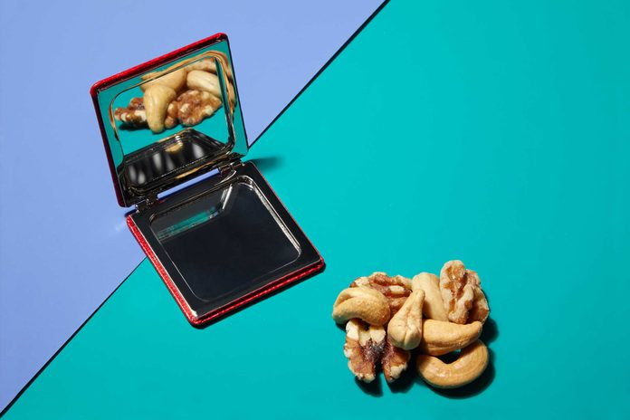 Illustration of portion control trick: compact mirror and mixed nuts