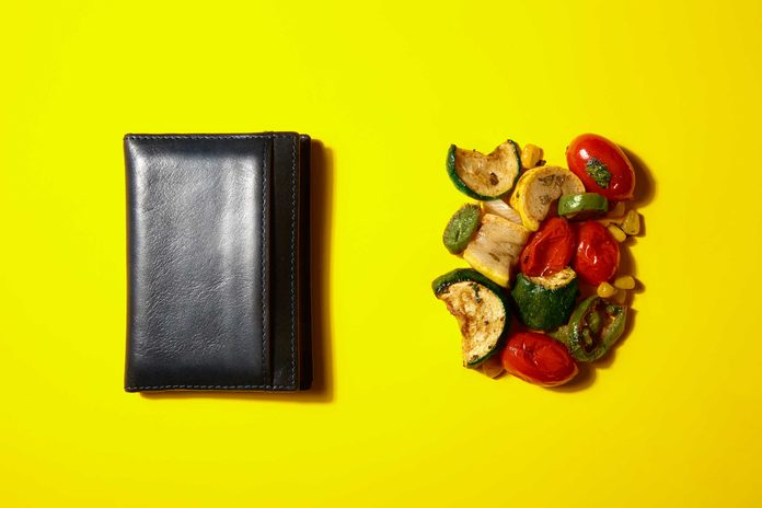 Illustration of portion control trick: wallet and fried veggies