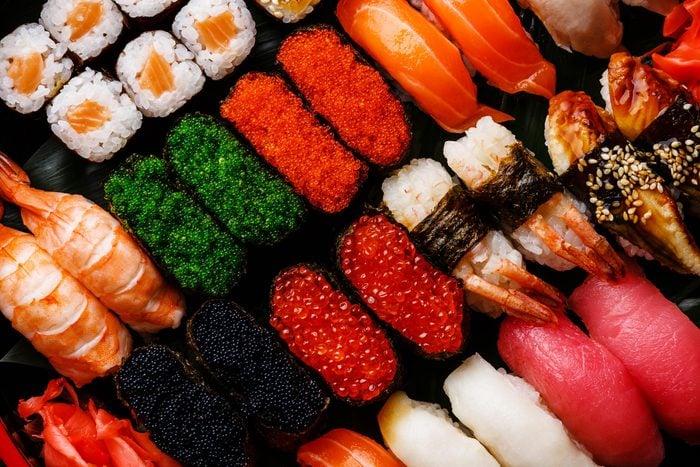 Rows of sushi and sashimi.