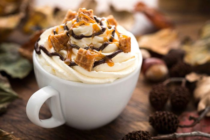 coffee topped with whipped cream, chocolate drizzle, and caramel