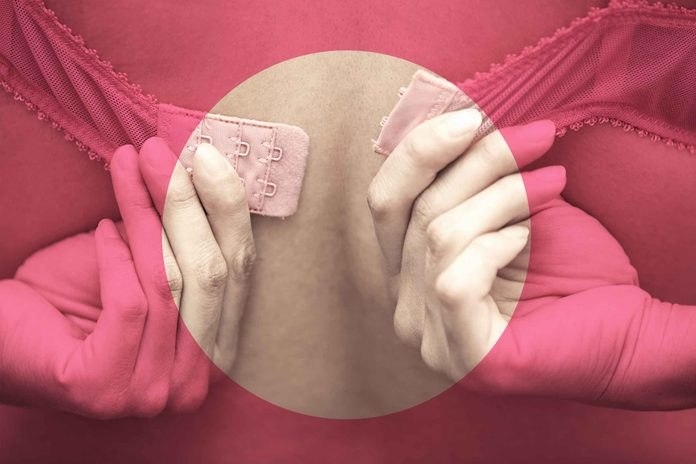 woman fastening her bra