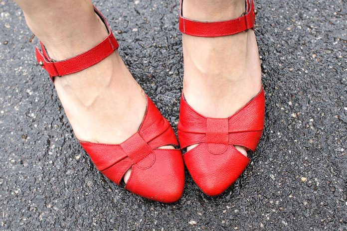 woman's feet in red sandals