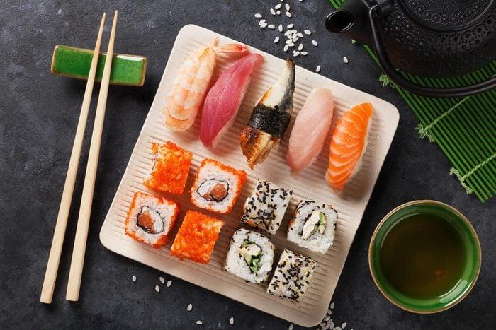 Plate of sushi and sashimi rolls.