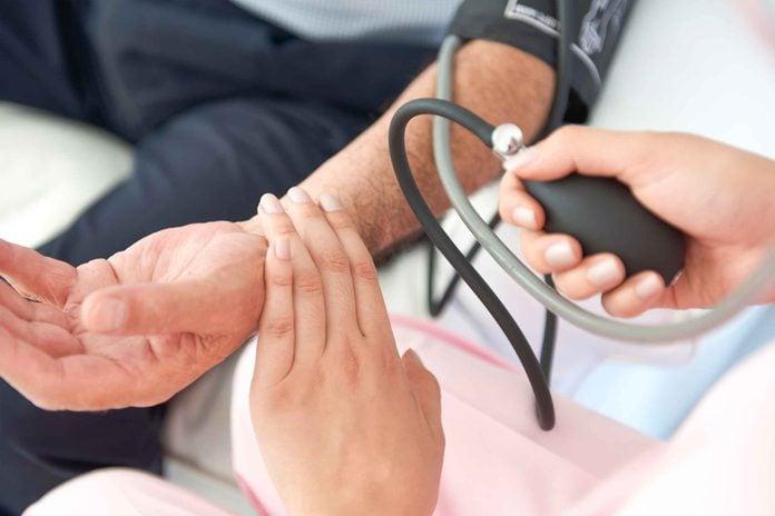 nurse checking a man's blood pressure