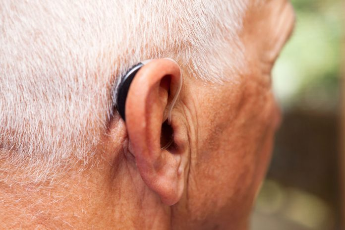 older man wearing a hearing aid