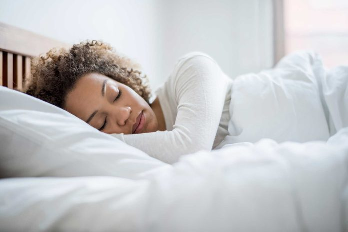 Woman sleeping in bed in the morning.