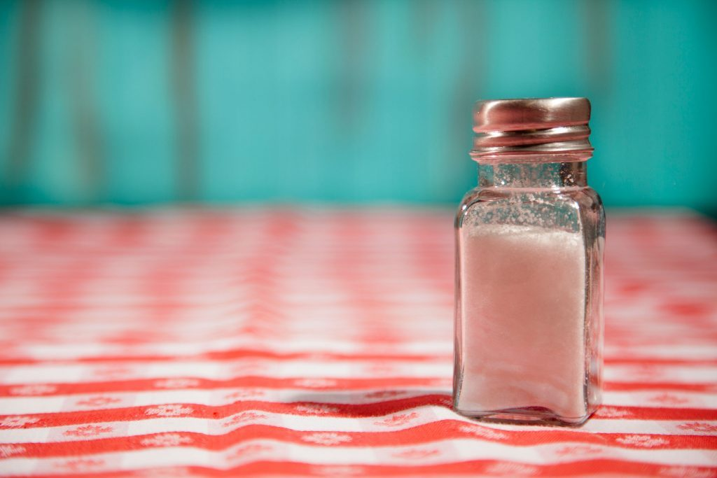 salt shake on gingham tablecloth