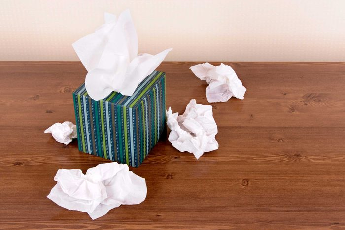 Box of tissues on a hardwood floor.