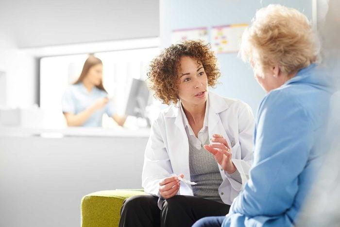 Female doctor talking to an elderly patient