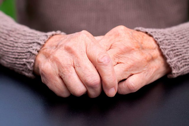 closeup of clasped elderly hands