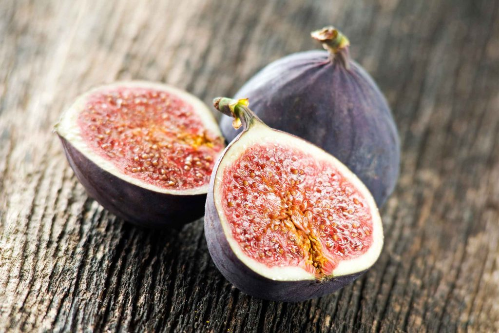 a whole fig and a fig sliced in half