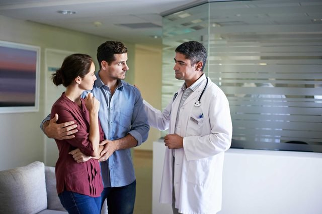 Doctor consulting with a couple