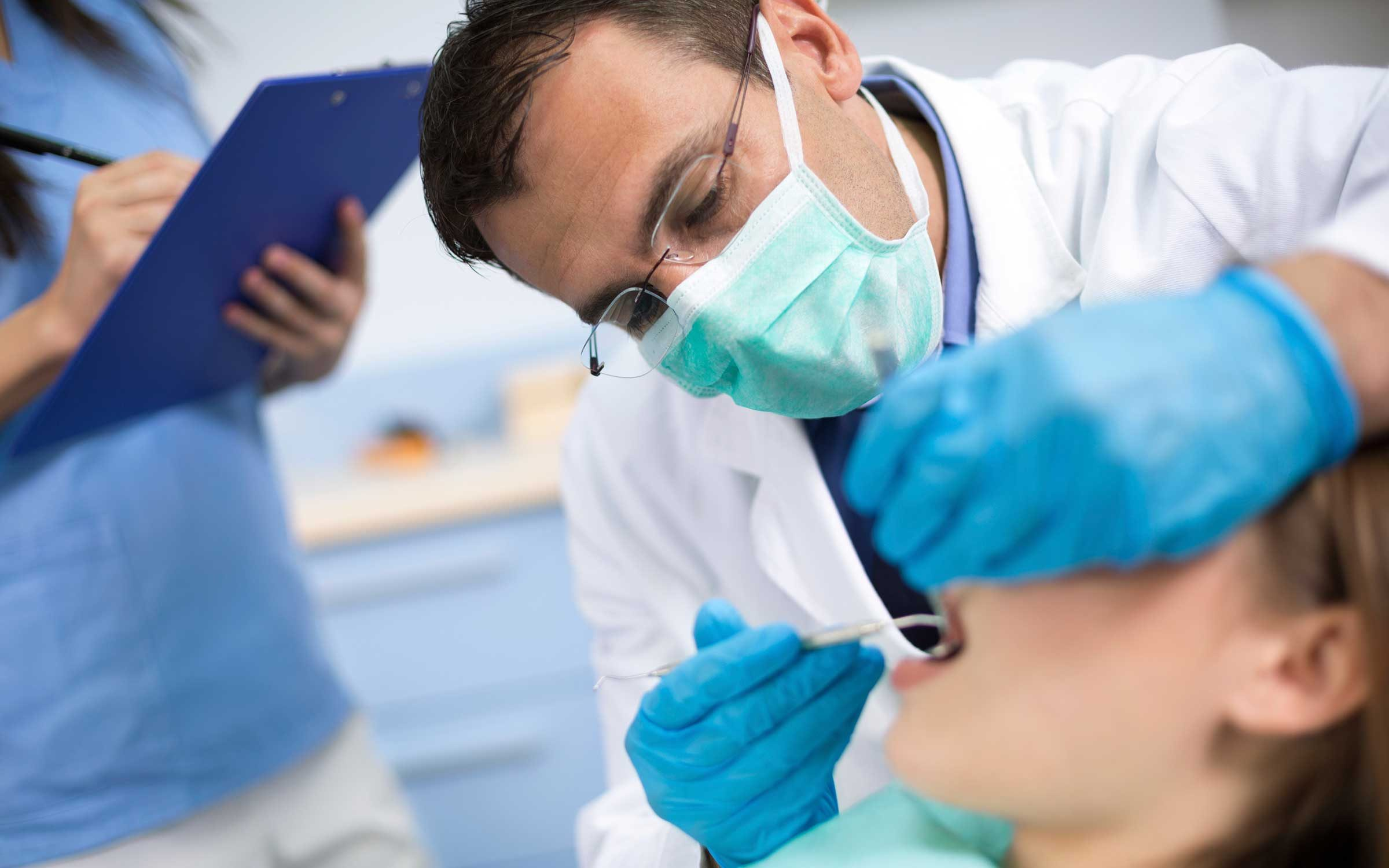 Dentist looking at patient's mouth