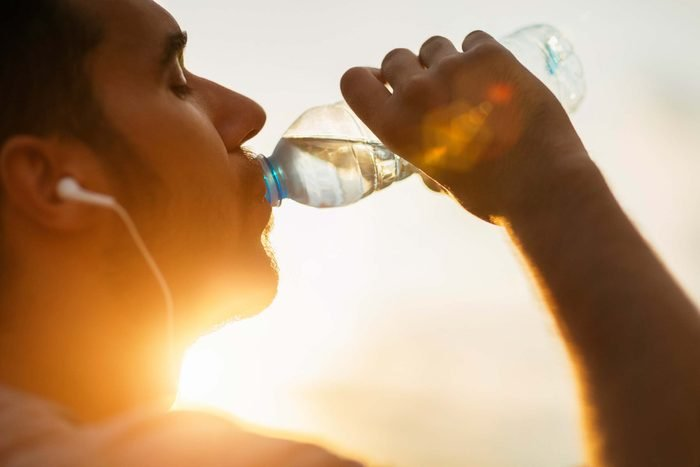 Man sipping from a water bottle.