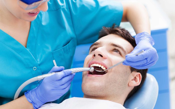 Man getting teeth cleaned