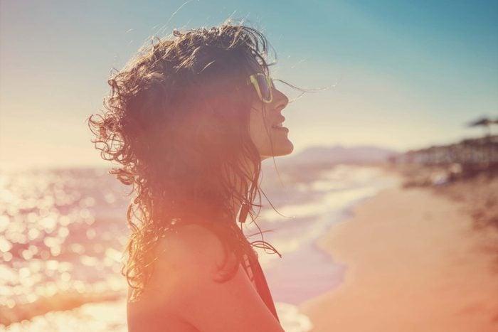 Woman on a sunny beach.