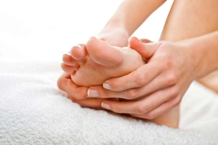 Woman rubbing her foot.