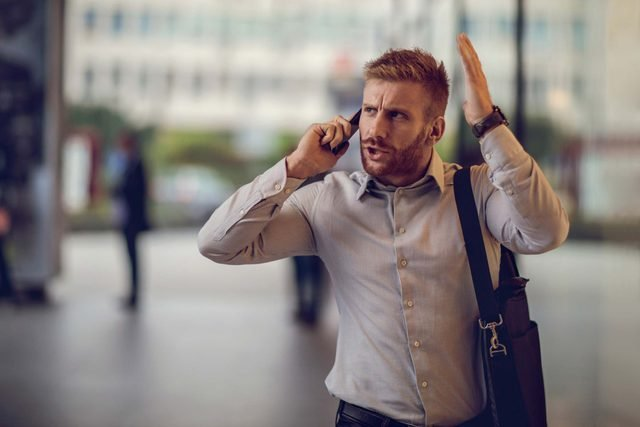 angry man talking on the phone