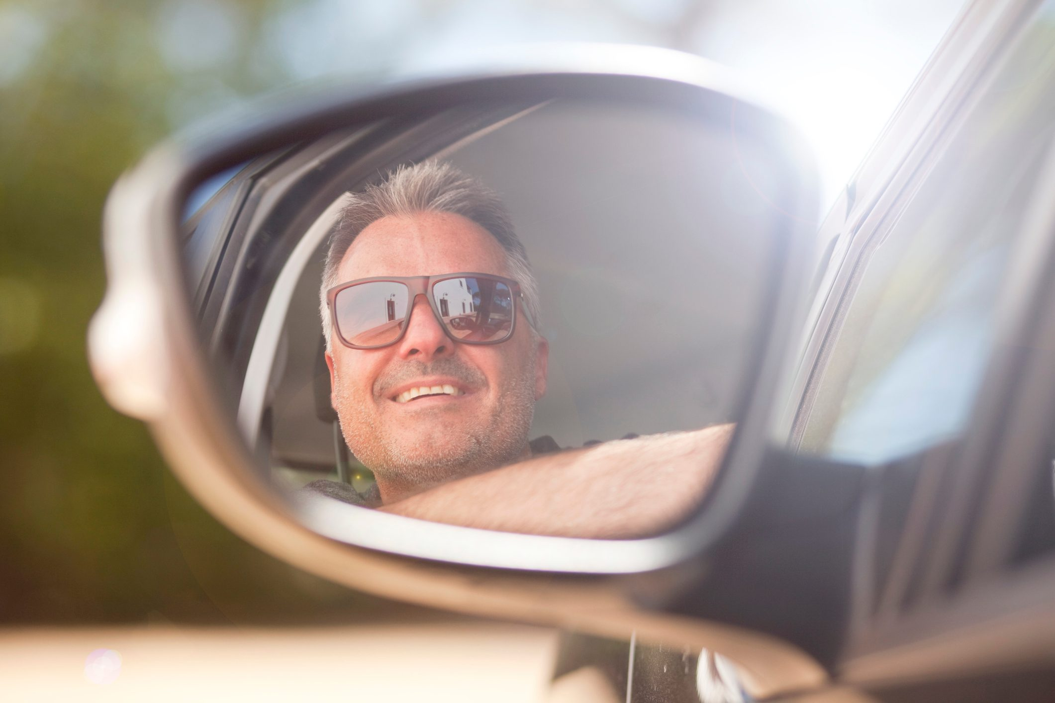 man in side view mirror reflection