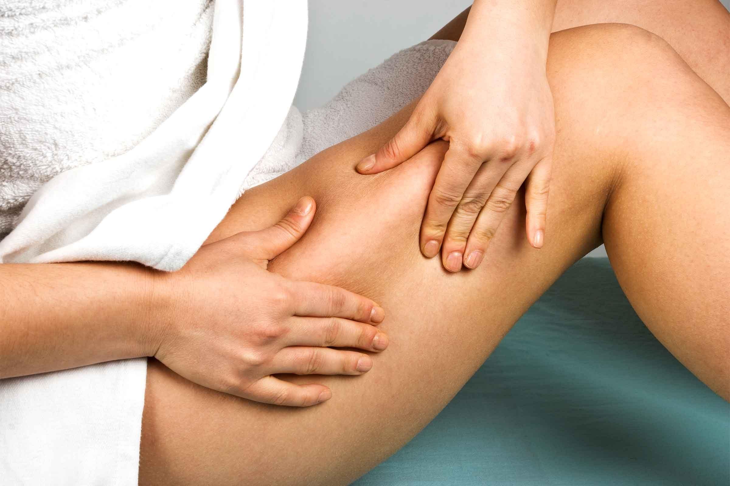 Woman looking at thigh