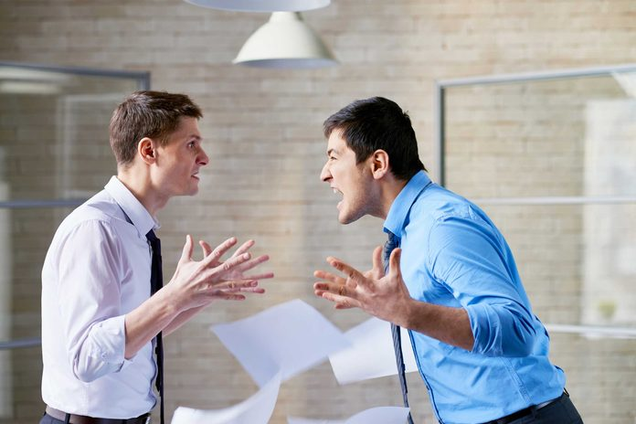 two men in shirts and ties arguing