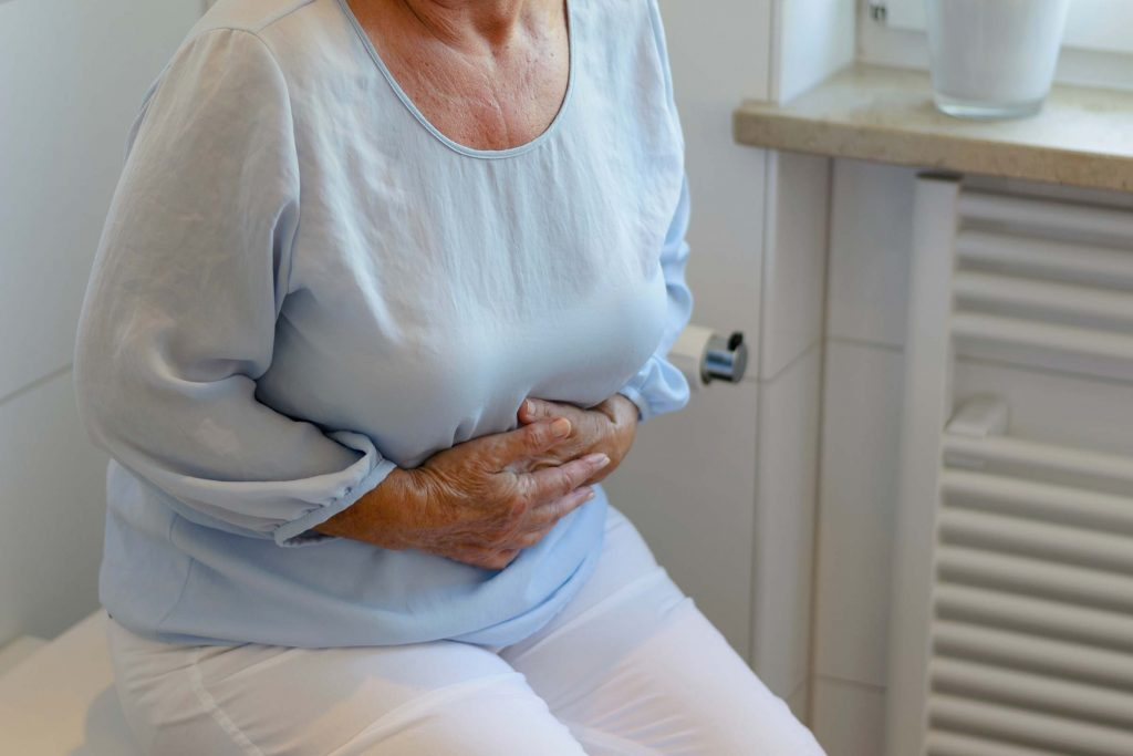 elderly woman holding her stomach