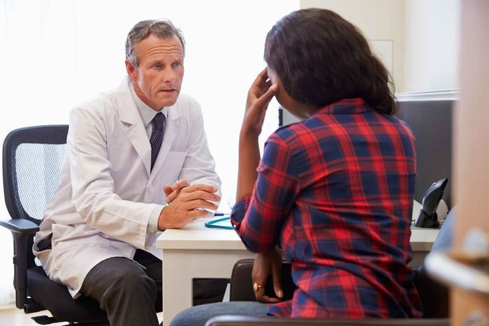 Patient and doctor talking in office