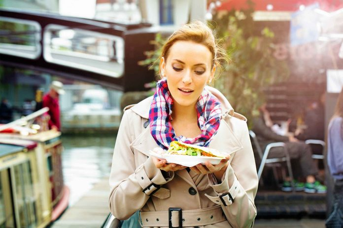 Woman walking with a plate of food