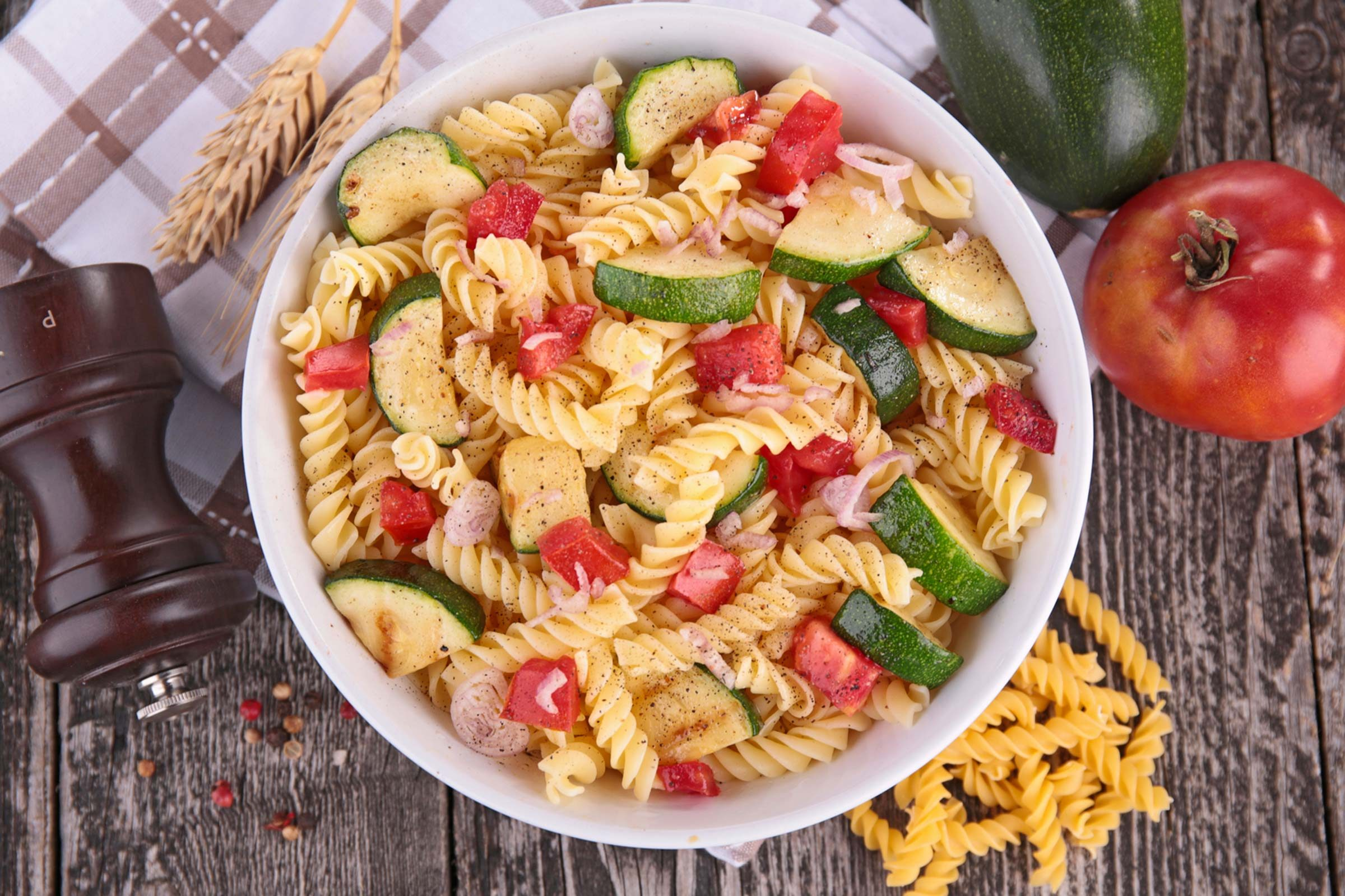 Bowl of pasta with fresh vegetables