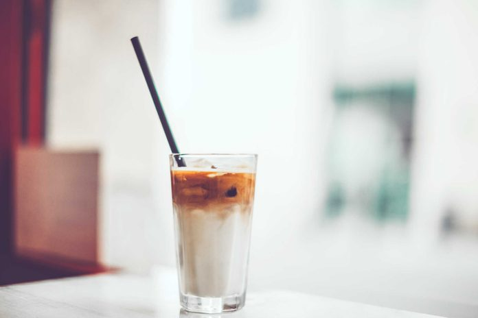 glass of iced coffee with milk with straw