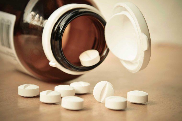 Bottle of diuretics spilling pills onto the table.