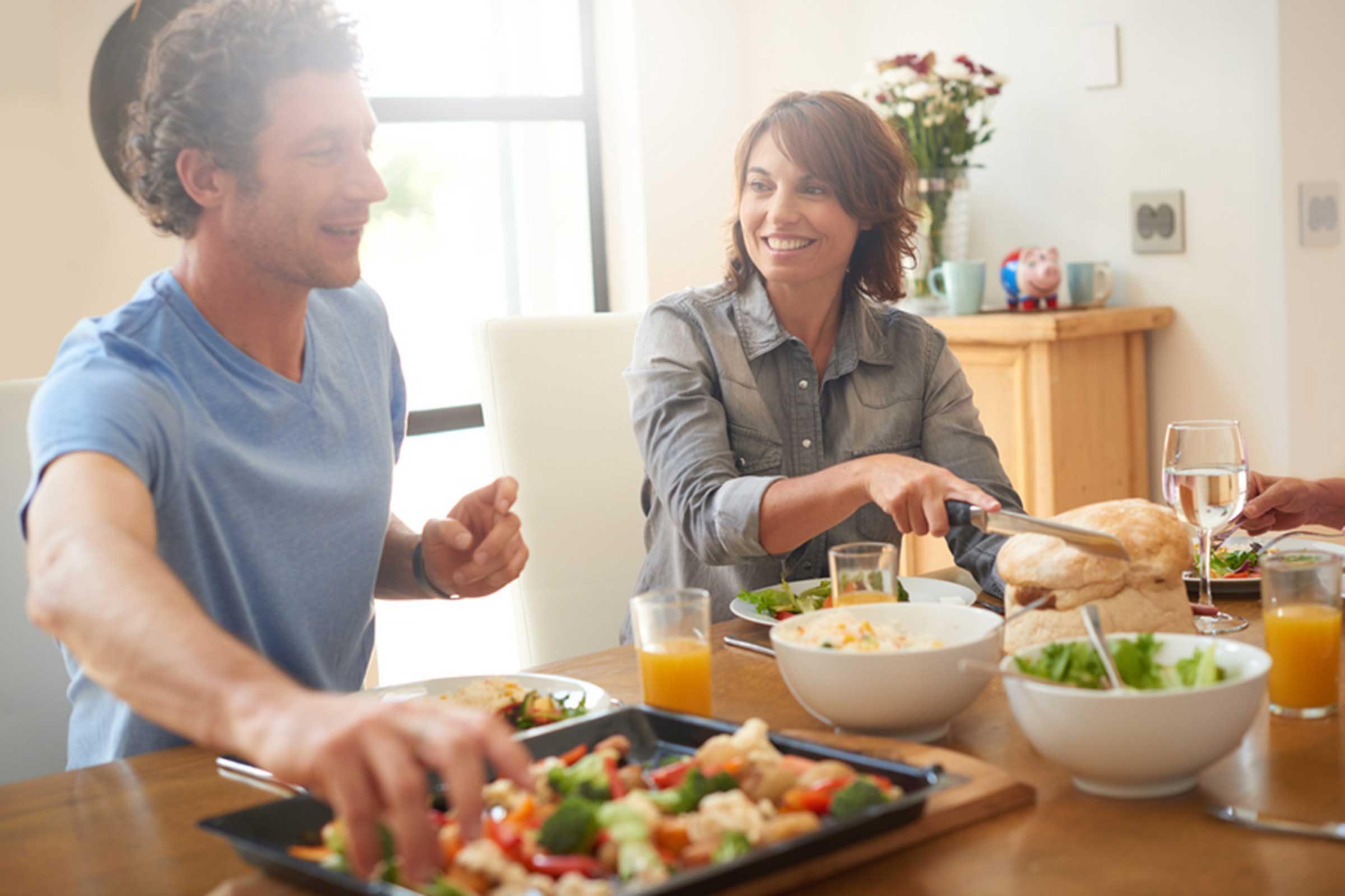 Man and woman eating at table