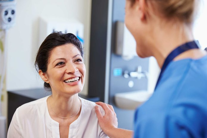 woman doctor talking to patient