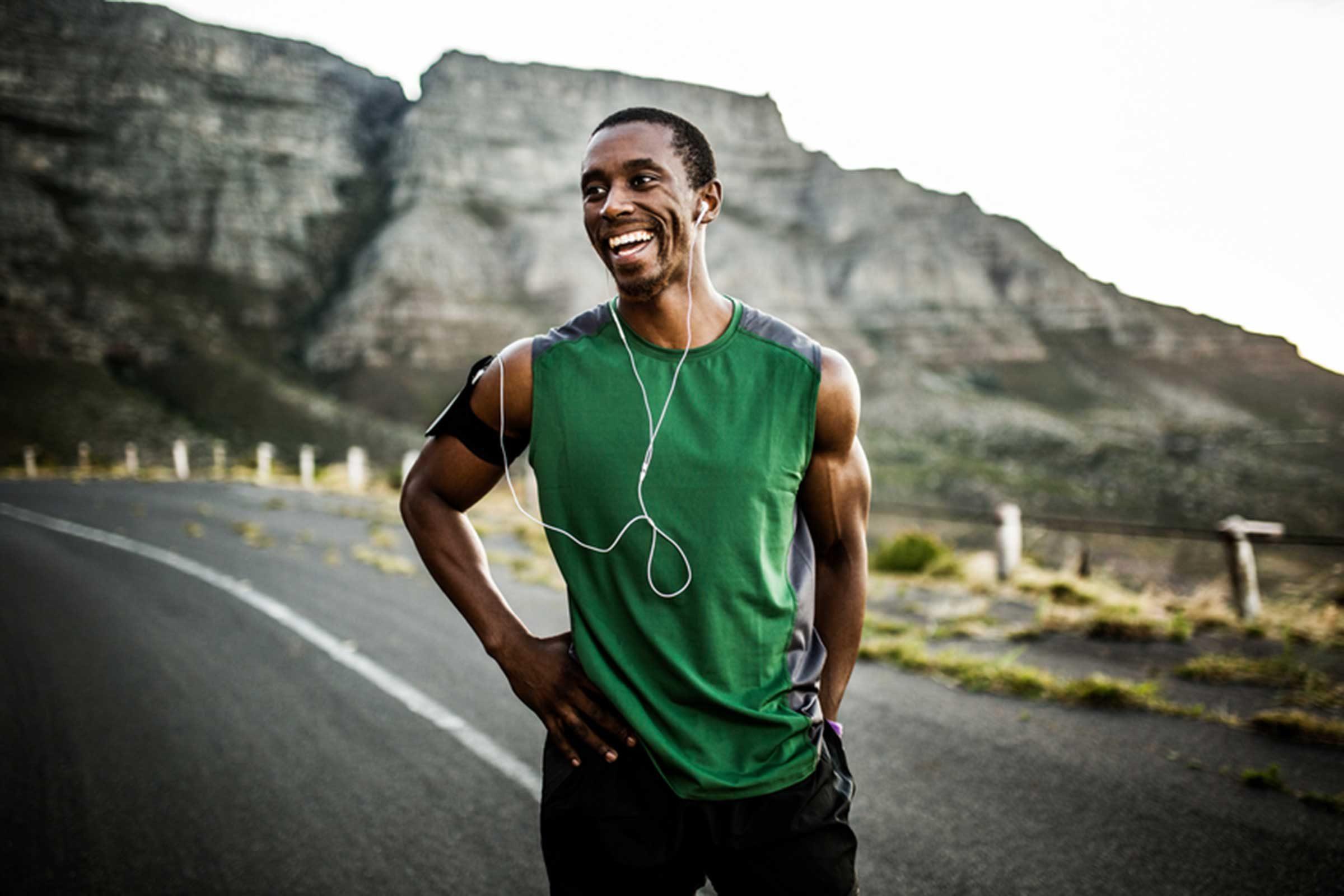 Man smiling during a run