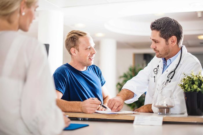 doctor discussing treatment with a patient