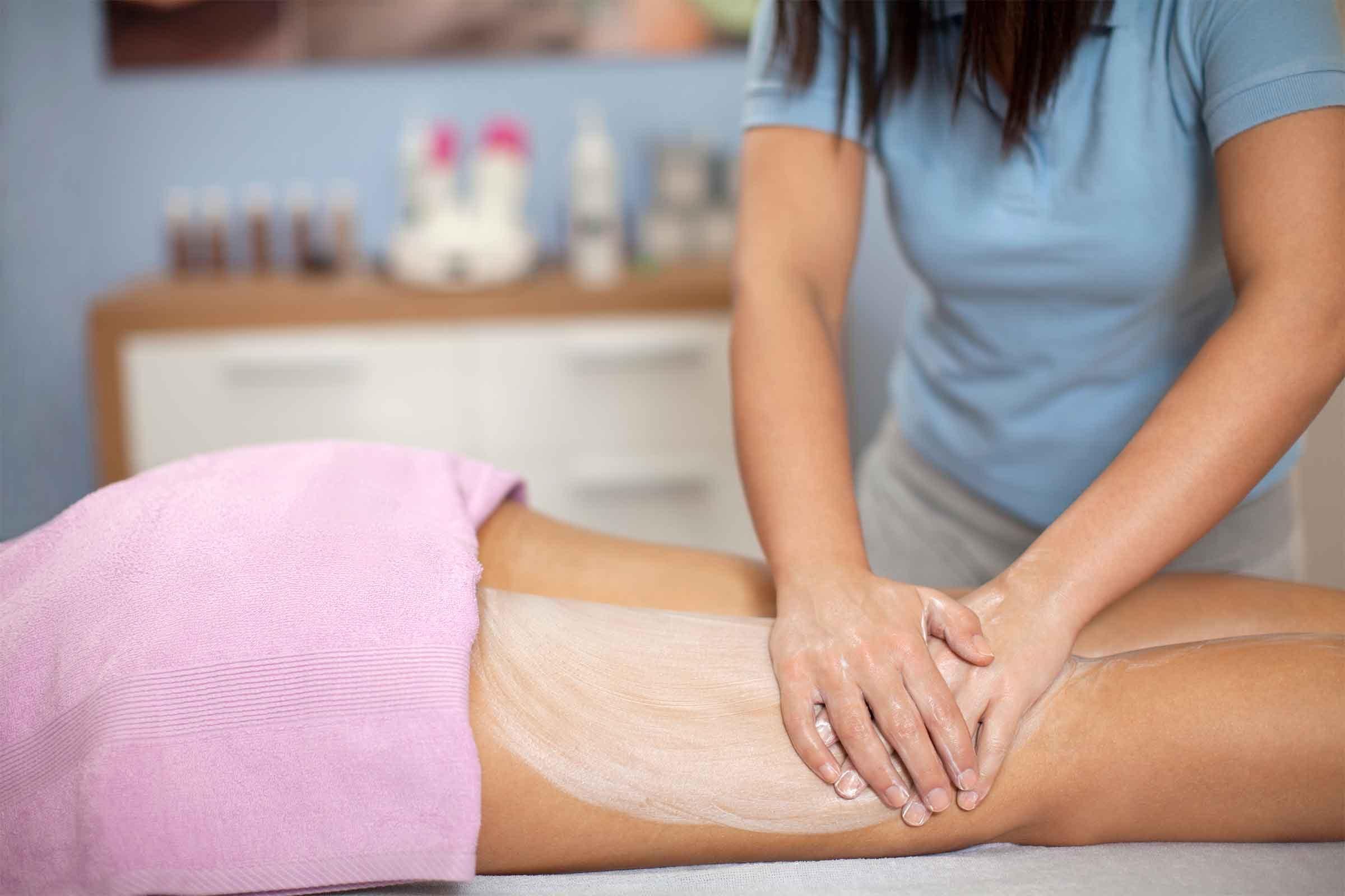 Woman giving a leg massage