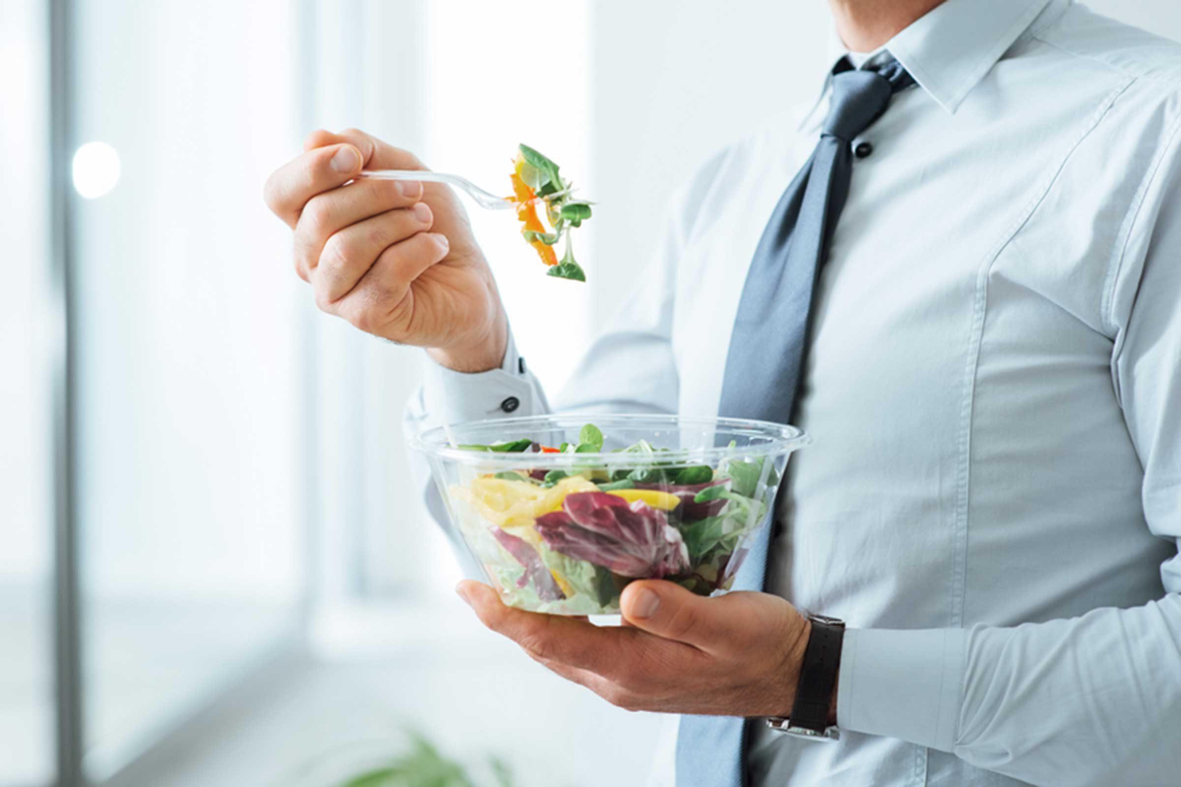 Man holding salad bowl