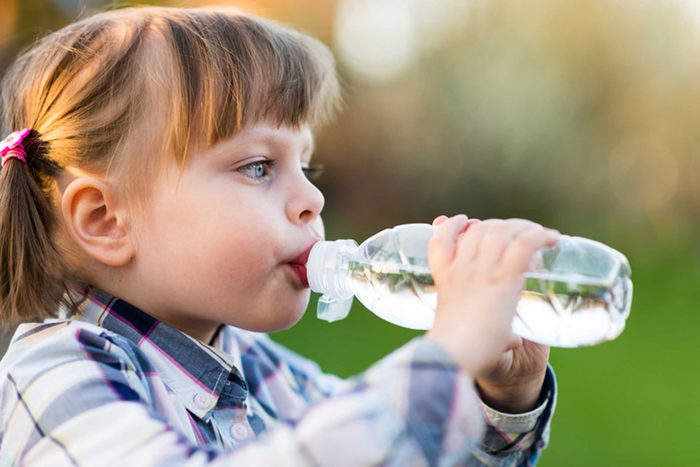 toddler girl drinking from a water bottle