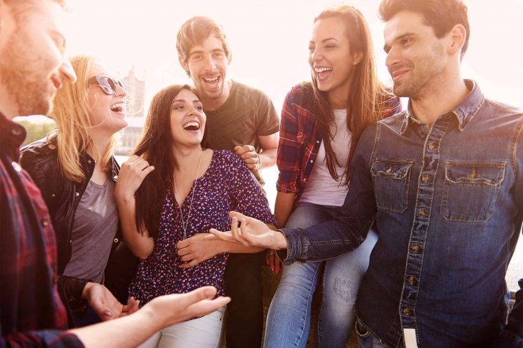 Group of young people talking and laughing.
