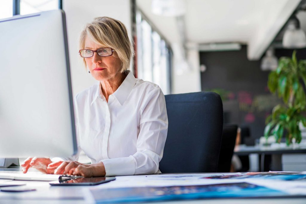 middle-aged woman on a computer