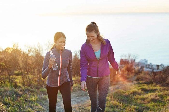 women walking on an outdoor path