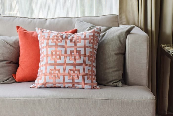 Gray couch with colorful pillows