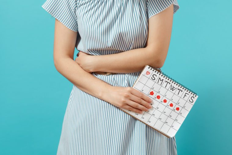 woman with calendar showing menstrual cycle