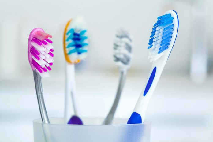 A cup of toothbrushes.
