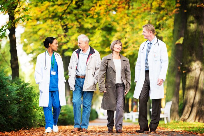 doctors and patients walking outdoors