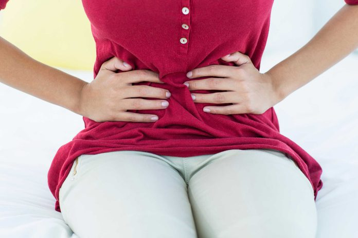 woman with her hands on her abdomen