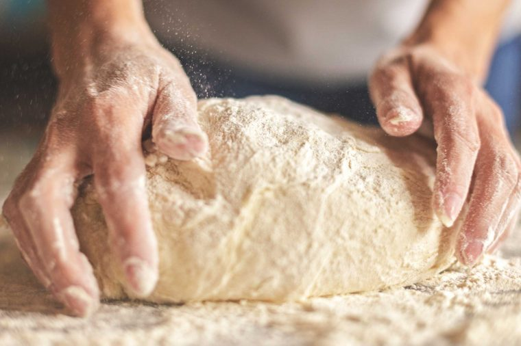 Woman kneading bread dough