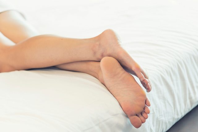 person lying down, close up of backs legs and feet
