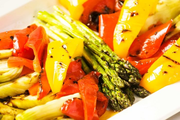 plate of cooked bell peppers, asparagus, and other vegetables